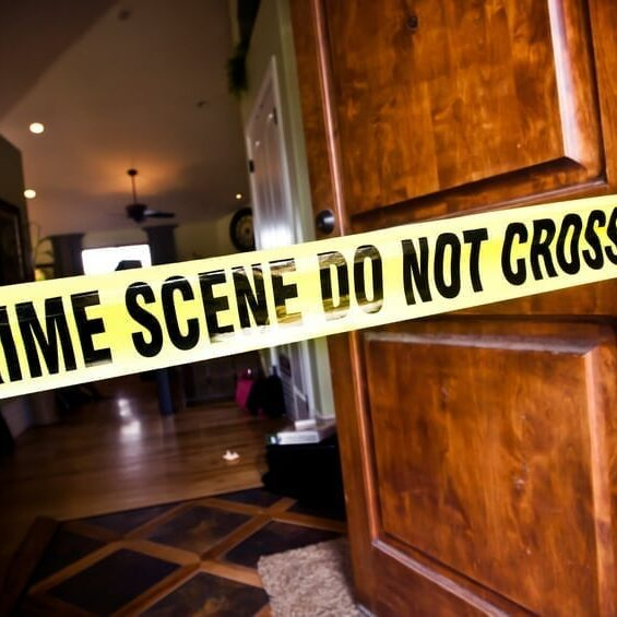 Crime Scene tape at the front door of a luxury home